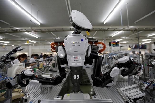 Quitan robots empleo en EU, no los mexicanos